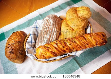 Assortment of fresh baked bread on table