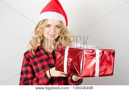 Smiling Woman In Santa Claus Hat Holding Cristmas Gifts