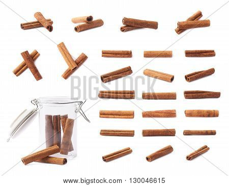 Set of different cinnamon sticks compositions isolated over the white background