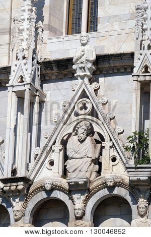 PISA, ITALY - JUNE 06, 2015: Saint, Baptistery decoration architrave arches, Cathedral in Pisa, Italy. Unesco World Heritage Site, on June 06, 2015
