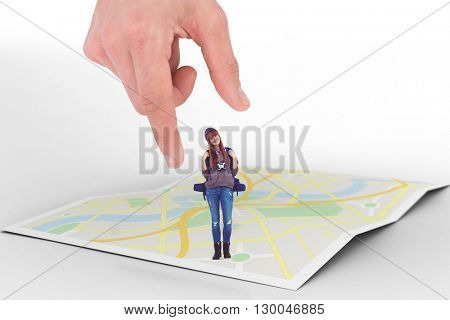 Smiling woman is standing and holding binoculars and backpack against city map