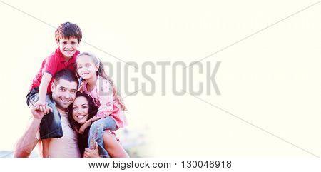 Parents giving children piggyback rides outdoors