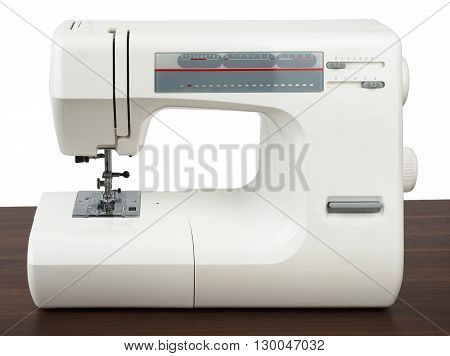 Sewing machine on table isolated on white background