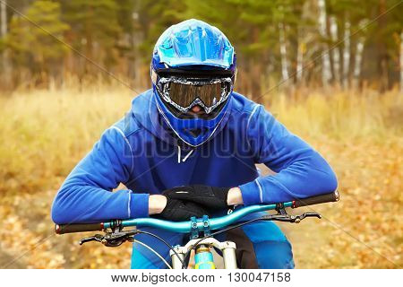 portrait of sporty man in a helmet with a mountain bike outdoor. extreme sport