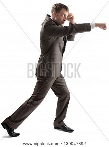 Angry caucasian business man in business formal outfit hitting isolated on white background