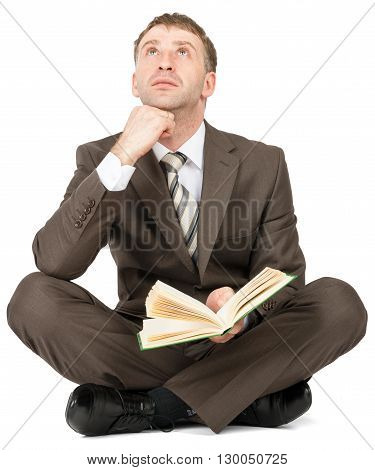 Man sitting with book and thinking isolated on white background