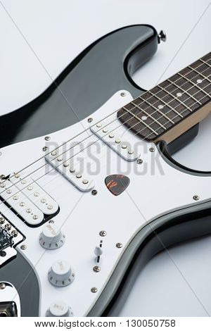 New and shiny electric guitar with mediator