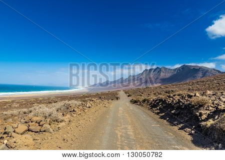 Road To Cofete Beach With Jandia Massif In The Background - Jandia Fuerteventura Canary Islands Spain