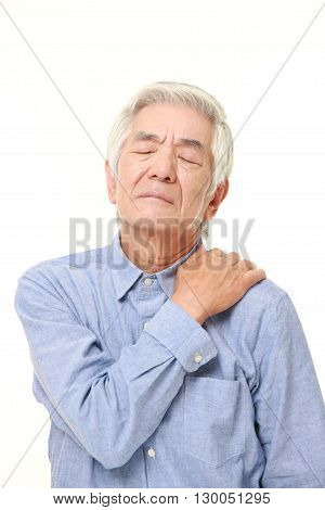 senior Japanese man suffers from neck ache on white background