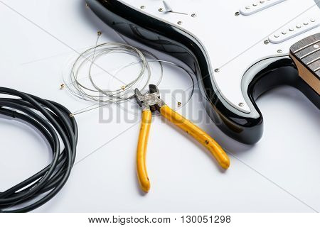 Electric Guitar With Yellow Nippers, Cable And Strings