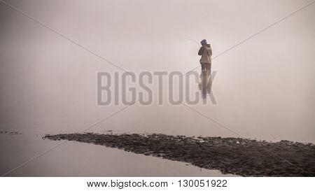 Fisherman in the Fraser River at Poplar Bar in Glen Valley on a Fog filled morning