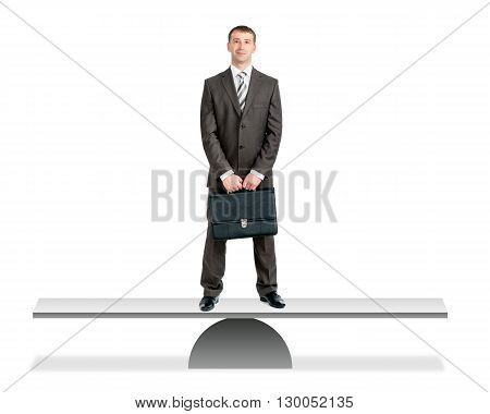 Businessman in suit with cuitcase standing on balance board in center, isolated on white