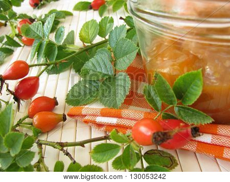 Homemade jam with rose hips in jar
