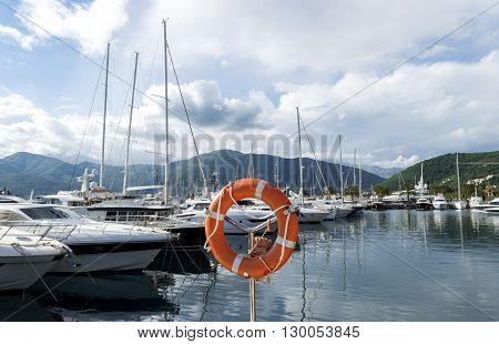 Mediterranean yacht marina. Tivat Montenegro. Cloudy sky and yacht reflections on the water.