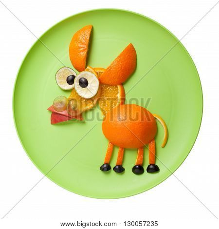 Donkey made of oranges on green plate