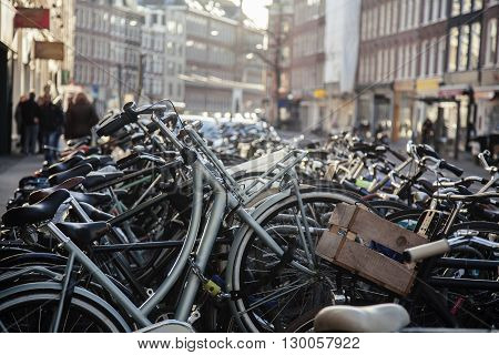 many bicycles on street of Amsterdam city, parking ideal traffic eco healthy lifestyle concept close up at sunlight