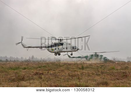 Zhitomir Ukraine - September 29 2010: Ukrainian Army military transport helicopters are landing in heavy storm during the military trainings