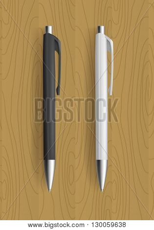 Realistic pens for identity design. Black and white pens on wooden table. Vector template illustration.
