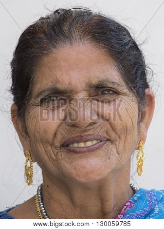 RISHIKESH INDIA - OCTOBER 20 2014 : Unidentified Indian woman visited a Buddhist temple in the holy city of Rishikesh near the River Ganges