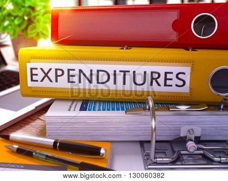 Expenditures - Yellow Ring Binder on Office Desktop with Office Supplies and Modern Laptop. Expenditures Business Concept on Blurred Background. Expenditures - Toned Illustration. 3D Render.