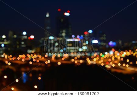 Night city skyline blurred lights of Perth. Bokeh effect