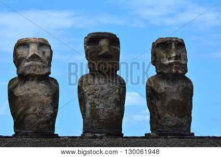Antiques Moais from Easter Island Polynesia in blue sky