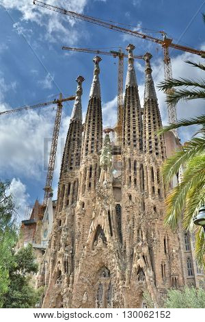 BARCELONA SPAIN - AUGUST 09 2015: La Sagrada Familia is a famous cathedral designed by Catalan architect Antoni Gaudi. UNESCO World Heritage Site