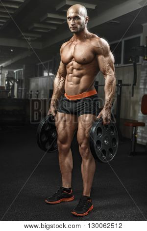 Very Power Athletic Guy Standing In Gym And Lokking At Camera