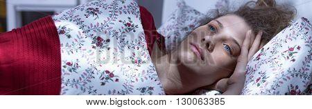 Woman Relaxing In Her Bedroom