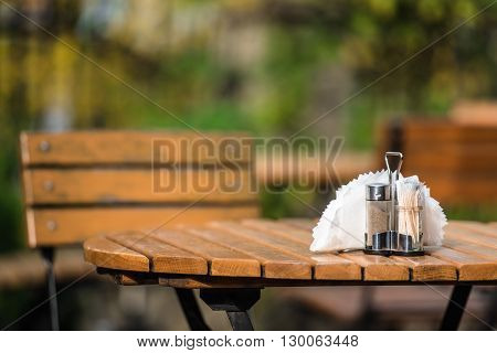 Outdoor Diner Bench with Restaurant Table Accessories.