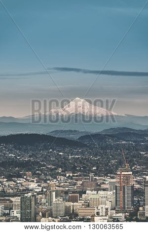 Portland Cityscape with Mt Hood on the Horizon. Vertical Photo.