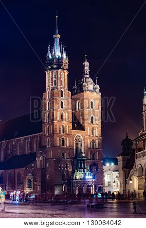 St. Marys Basilica in Cracow. Krakow Market Square at Night.