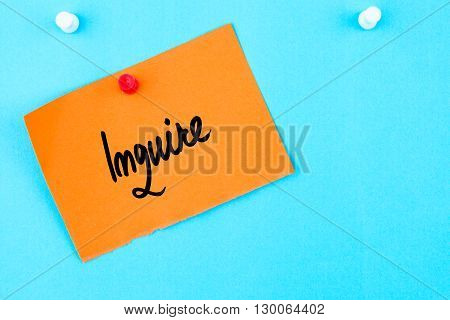 Inquire Written On Orange Paper Note