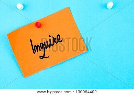 Inquire Written On Orange Paper Note