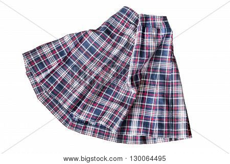 Folded uniform tartan skirt on white background