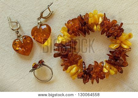 Amber Jewelry: bracelet earrings ring. Amber jewelry closeup.