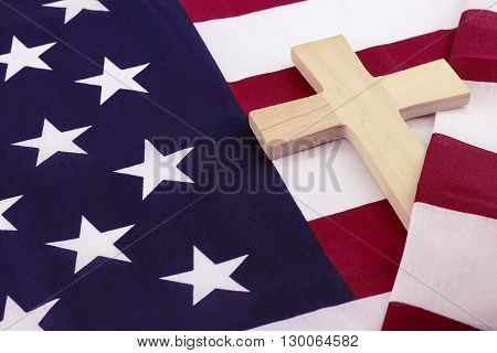 Wooden cross wrapped in a American flag