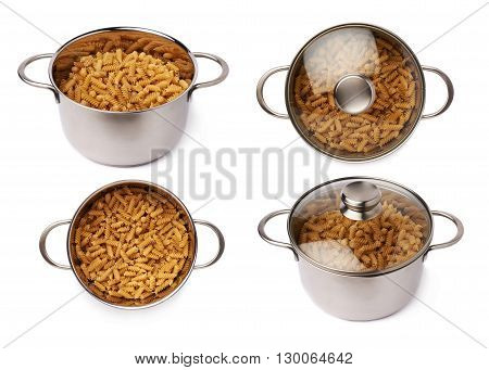 Set of metal pan filled with dry rotini yellow pasta over isolated white background, different foreshortenings