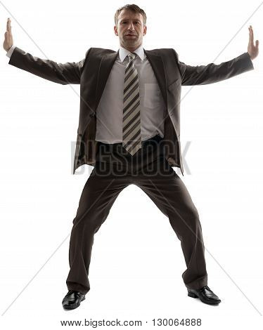 Business man stretching his arms to sides isolated on white background