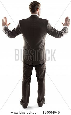 Rear view of young business man touching copy space isolated over white background