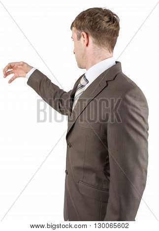 Man in suit reaching for something from above with empty copy space, successful man with idea grabbing something
