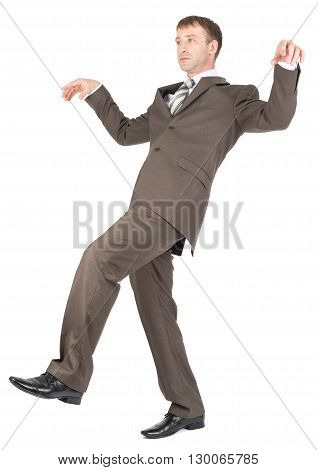 Businessman walking carefully, try to balance himself. Isolated on white background