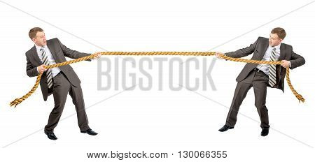Tug war, two businessman pulling rope in opposite directions isolated on white background