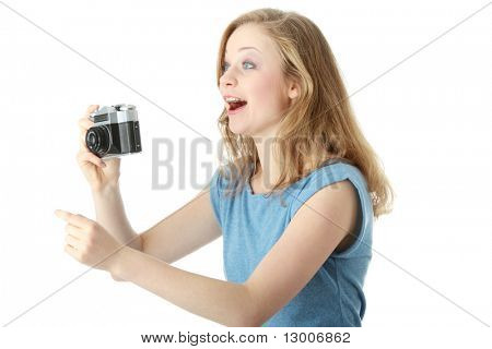 Pretty girl making photo using classic slr camera. Isolated on white