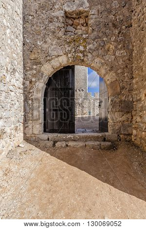 Open gate of the Sesimbra castle, Portugal.