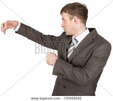 Holding something of hand shape on white background. Businessman hitting copyspace