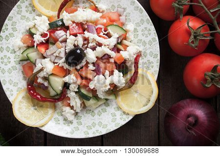 Shopska salad with cheese ,olives, tomato, cucumber, onion and chili peppers