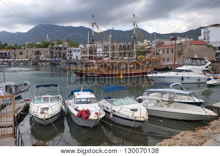 KYRENIA, CYPRUS - MAY 19, 2012: Yachts and ships in the old harbour of Kyrenia cloudy day. North Cyprus