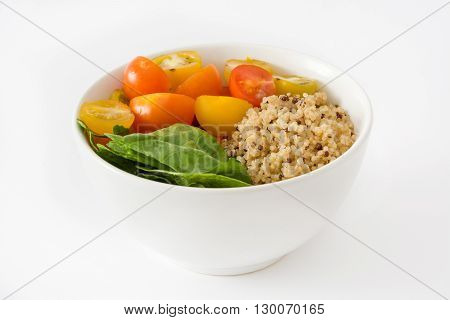 Quinoa salad in bowl in  tomatoes and spinach isolated on white