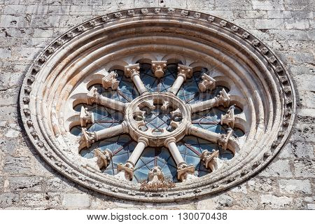 The Gothic Wheel Window also called as Rose Window or Catherine Window in the Santa Clara Church. 13th century Mendicant Gothic Architecture. Santarem, Portugal.